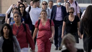 "People walk over London Bridge on ""Freedom Day"", marking the end of coronavirus restrictions."