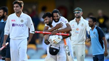 Rishabh Pant celebrates victory in Brisbane with his teammates.