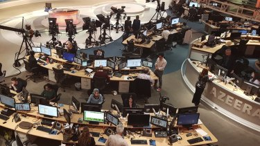 Al-Jazeera staff work at their TV station in Doha, Qatar.
