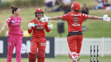 Winning ways: Player of the Match Courtney Webb (centre) celebrates with Molly Strano after sealing victory for the Renegades.