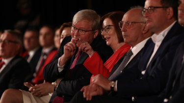 Former prime ministers Rudd and Gillard share a laugh.