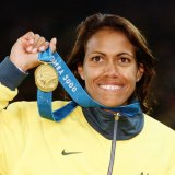Cathy Freeman with her gold medal for the 400 metres.