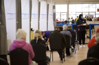 Victorians wait for a jab at the Melbourne Showground vaccination hub on Wednesday.