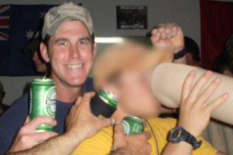 """SAS soldier Ben Roberts-Smith carousing with US soldiers and a prosthetic leg taken from an Afghan man whom he killed. The leg was used as a beer drinking vessel at the SAS base in Afghanistan and was known as """"Das Boot""""."""
