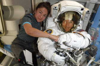 Christina Koch and Jessica Meir pose ahead of their spacewalk. They had to wait for suits that fitted them.