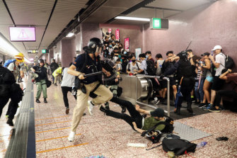 Police attempt to arrest protesters at Prince Edward Station in Hong Kong.
