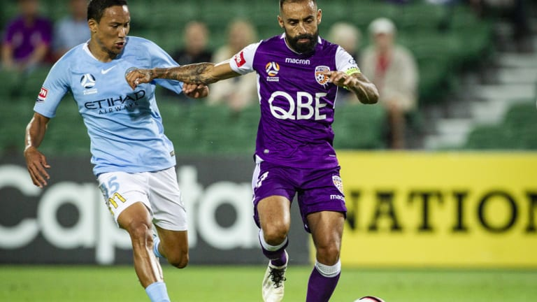 Giving chase: Melbourne City's Kearyn Baccus pressures Perth's Diego Castro.