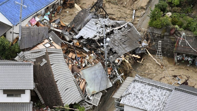 Residential buildings are damaged by a landslide in Sakacho, Hiroshima.