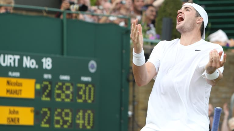 John Isner reacts after his epic victory over Nicolas Mahut at Wimbledon in 2010.