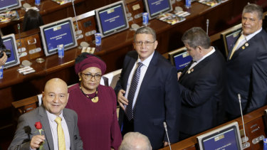 From left, Carlos Lozada, Victoria Sandino, Pablo Catatumbo, Marco Calarca and Olmedo Ruiz, all former members of the demobilised FARC arrive at Congress to take up their seats in Bogota on Friday.