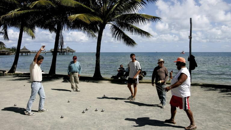 Locals play petanque on the beach in Noumea, the capital of New Caledonia.