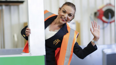 Labor MP Anne Aly poses for photos with a bus during the 2019 Federal Election.