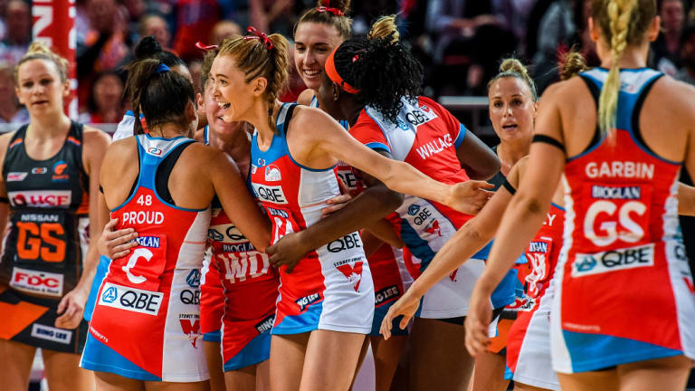 On the up: The Swifts celebrate victory over the Giants in round three.