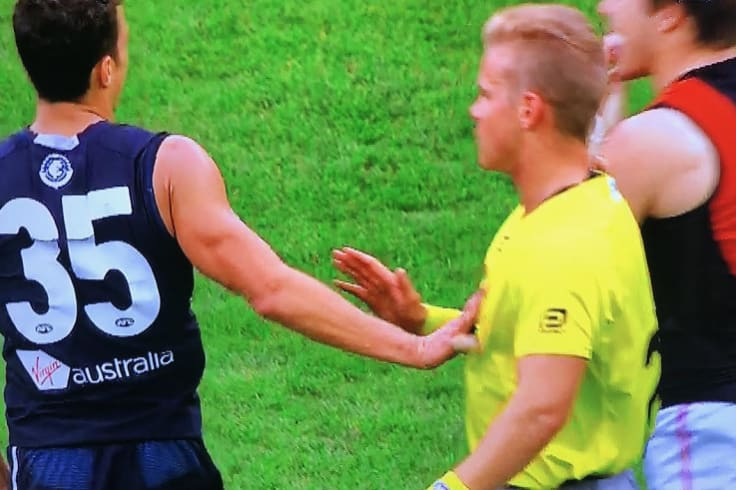 Ed Curnow makes contact with an umpire.