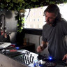 Virus means this DJ can't spin the platters, so he's delivering them