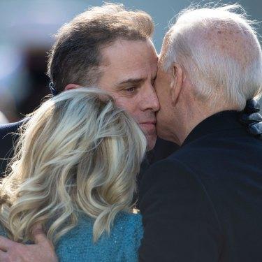 Hunter Biden embraces his father, Joe, and Jill Biden during Joe's presidential inauguration ceremony in Washington inJanuary.