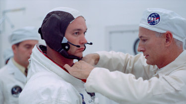 NASA pilot Michael Collins suiting up before the Apollo 11 mission.