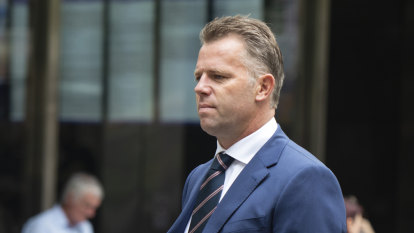 Ex-footballer Glenn Archer wins appeal over runner assault conviction