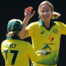 Ellyse Perry (centre) is congratulated by Alyssa Healy (left) and Beth Mooney. All will be missing from an exhibition match in India.