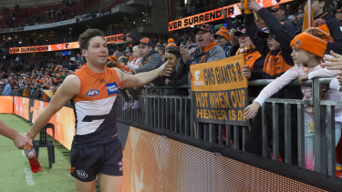 Follow me: Toby Greene soaks in the post-siren glory after leading the GWS Giants to a big win over Collingwood.