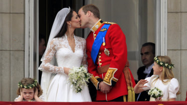Prince William and Kate, Duchess of Cambridge kiss on the balcony of Buckingham Palace after their wedding in 2011.