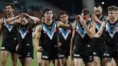 Port Adelaide players leave Adelaide Oval dejected on Friday night.