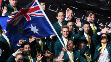 Flag bearer Mark Knowles leads the Australian team.
