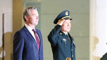 Australian Minister of Defence Christopher Pyne (right) and Chinese Minister of National Defence Wei Fenghe (centre) reviewing the PLA guards of honour in Beijing.