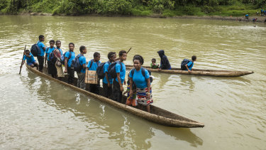Students travelling to schools near Lake Kutubu. Thousands had their education interrupted by the earthquake.