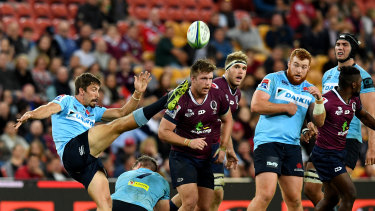 NSW halfback Jake Gordon clears the ball during a match against the Queensland Reds last year at Suncorp Stadium.