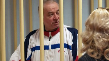 A photo dated August 9, 2006, shows Sergei Skripal talking from a defendants' cage to his lawyer during a hearing at the Moscow District Military Court.