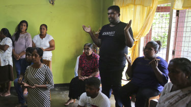 Relatives of Sri Lankan couple Rohan Marselas Wimanna and Mary Noman Shanthi, who were killed in Easter Sunday bomb blasts pray at their residence on the seventh day of mourning in Negombo, north of Colombo, Sri Lanka.