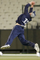 Screamer: Will Sutherland takes a diving catch for Victoria at the MCG.