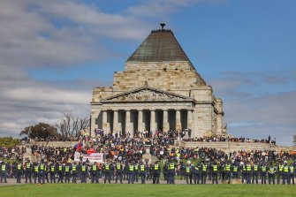 Police surround the protesters at the Shrine of Remembrance on Wednesday.