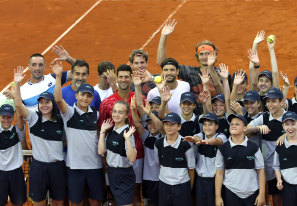 Djokovic poses with players and volunteers at his ill-fated Adria Tour.