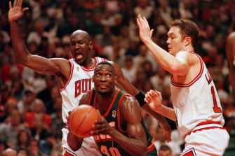 Chicago's Michael Jordan and Luc Longley defend Seattle's Shawn Kemp during game six of the NBA Finals in June 1996.
