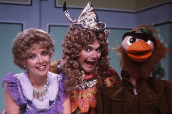 Jacki MacDonald, Daryl Somers and Ozzie Ostrich in costumes.
