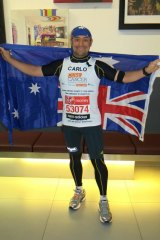 Mr Tonini after completing the London Marathon.