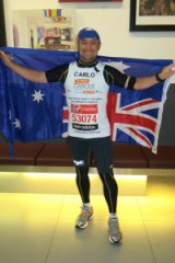 Mr Tonini after completing the London Marathon.