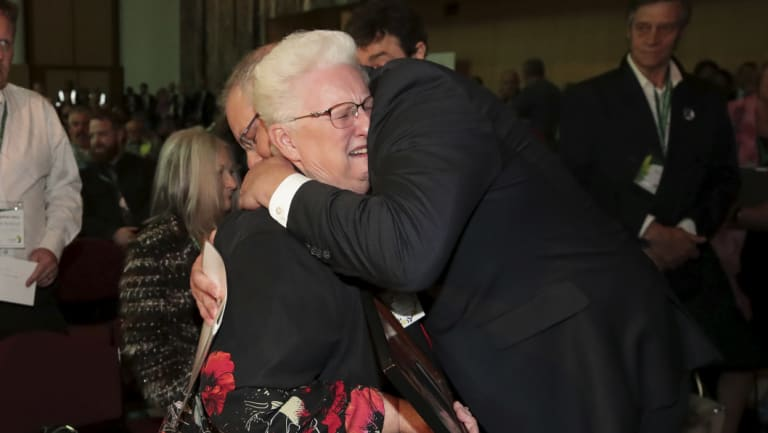 Mr Morrison is embraced by a survivor.