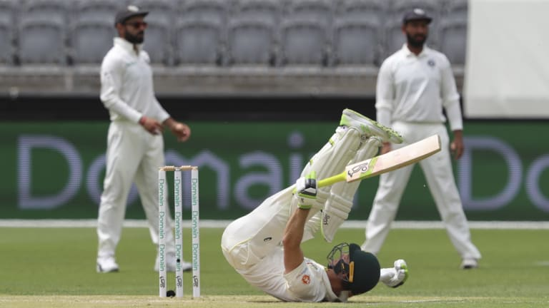 Evasive: Tim Paine avoids a short ball while batting.