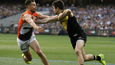 Deledio the Giant takes on old Tiger teammate Trent Cotchin.