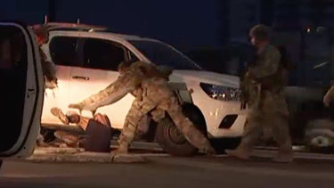 Police arrest Ben Hoffmann in Darwin on Tuesday after four people were shot dead and one was injured.