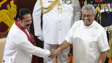 Sri Lanka's president Gotabaya Rajapaksa, right, greets his brother Mahinda after appointing him as prime minister on Thursday.