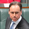 Ministers trade blows over private health and public hospitals