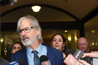 John Jarratt speaks to the waiting media pack after he was found not guilty.