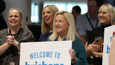 Airport staff greet the first passengers back from Sydney since the Queensland borders re-opened on Tuesday.