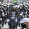 Bolsonaro fined for flouting mask rules at motorcycle rally