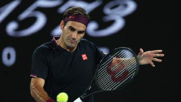 Federer plays a backhand during an easy win against Filip Krajinovic.