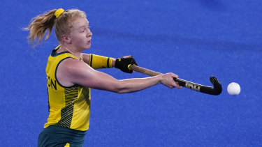 Australia's Amy Rose Lawton knocks the ball out of the air against New Zealand .
